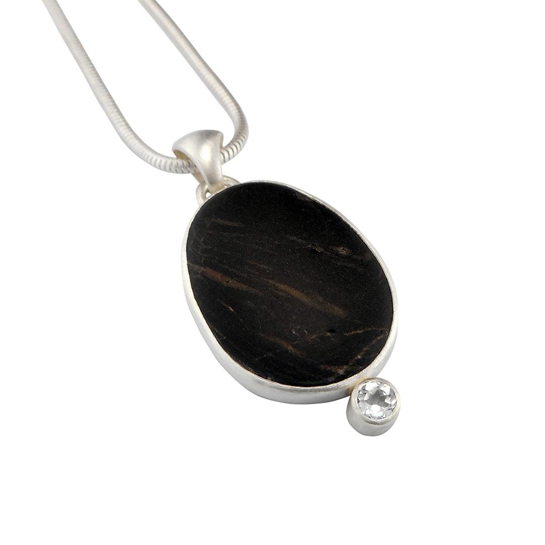 Handmade beach pebble and white topaz silver pendant.