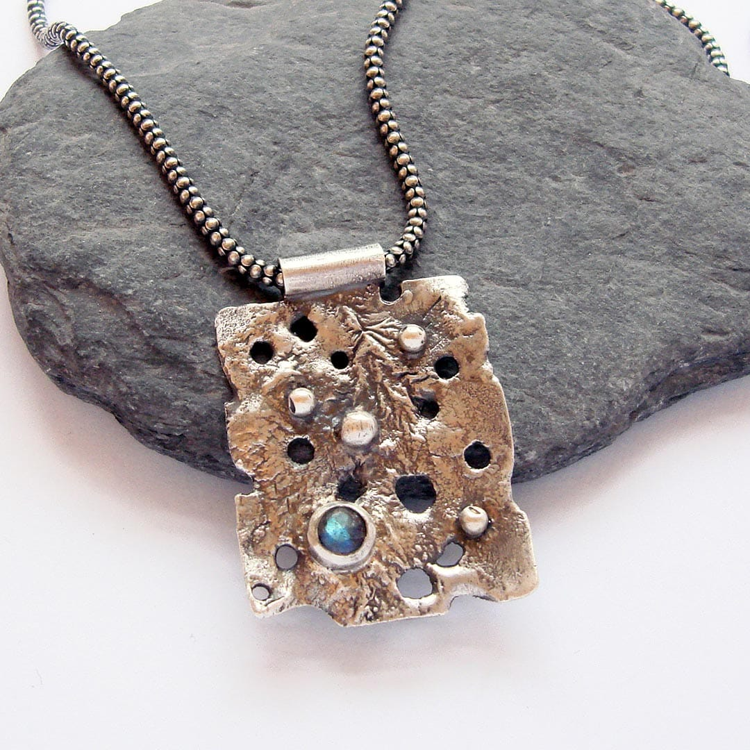 one off rugged heat textured pendant with labradorite