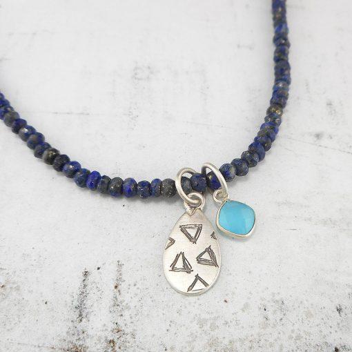 Lapis lazuli necklace with etched pendant