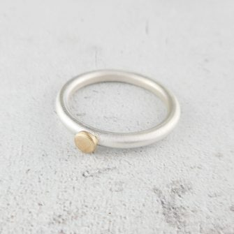 simplicity ring in silver with 9 ct gold dot