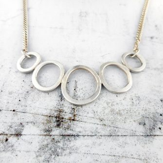 Rock pools bib necklace in brushed silver