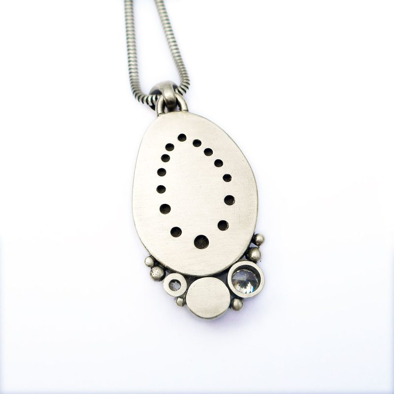 back of beach pebble and silver pendant