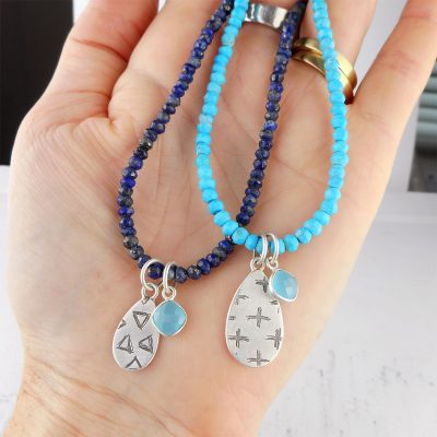 turquoise and lapis necklaces with etched pendants