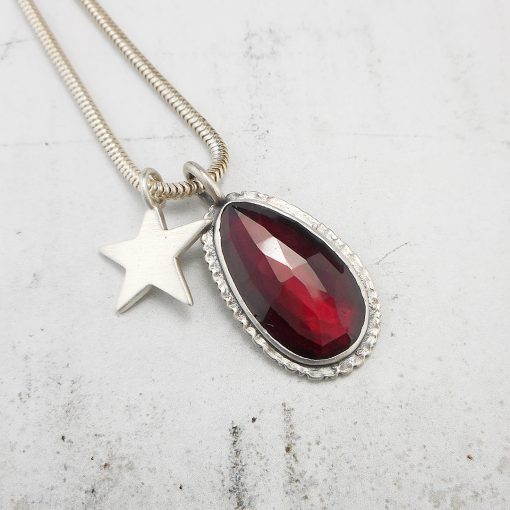 Red garnet pendant with ruffle edge and patina