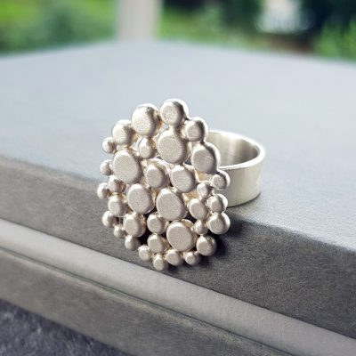 Cobblestone ring in brushed silver, cluster of tiny pebbles