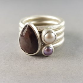 brown sapphire and mauve pearl stacking rings