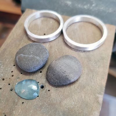 commissions on the bench, aquamarine, beach pebbles