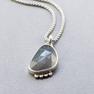 Grey sapphire pendant in silver and 9ct gold