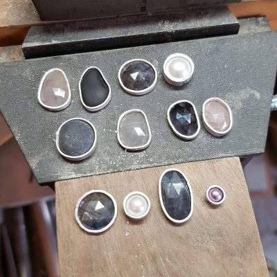 pebbles and sapphires on the bench