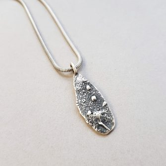 Rugged textured silver pendant