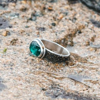 Teal blue rose cut Tourmaline on a textured silver band ring