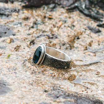 Dark blue rose cut Tourmaline on a textured silver band ring