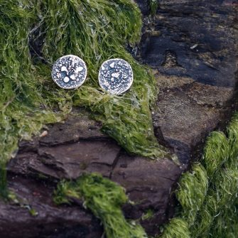 Textured rugged circular silver stud earrings