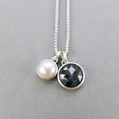 Grey sapphire, white pearl and brushed silver pendant